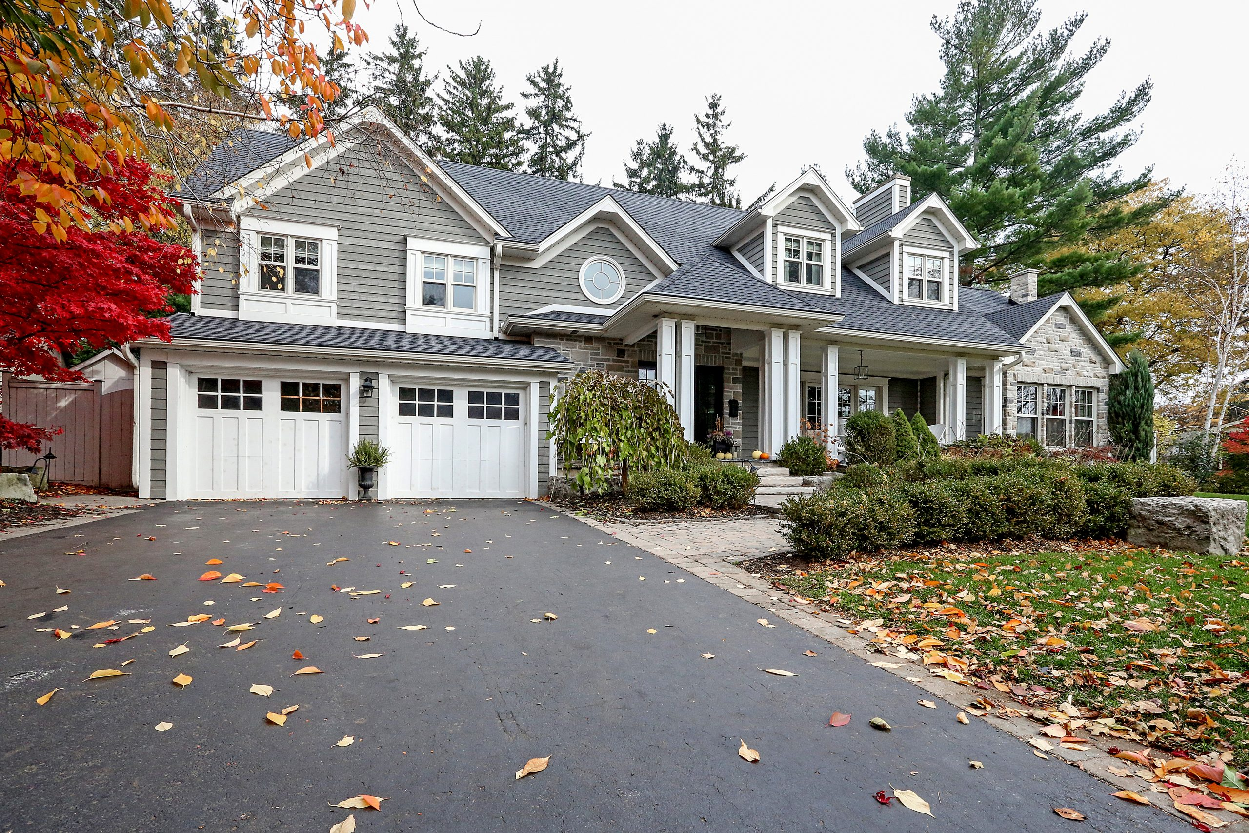 A photo of a home's exterior, focusing on the roof and gutters, as this is an important step to take in preparing your home for summer.