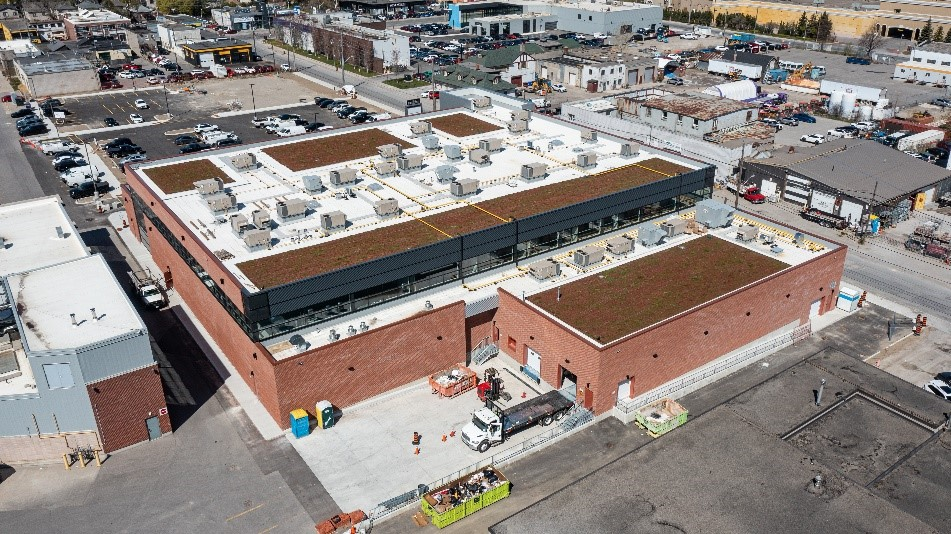 The roof of a comercial retail building with a vegetated green roof system. The brown patches is the green roof system.