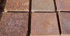 Brown bricks made from the concrete altnerative Ferrock.