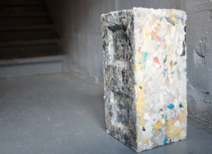 A building block made from recycled materials. This shows how recycled plastics can be used to create building blocks as a n eco-friendly substitute.