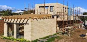 Image of Timbercrete, a concrete alternative, used in building a home.